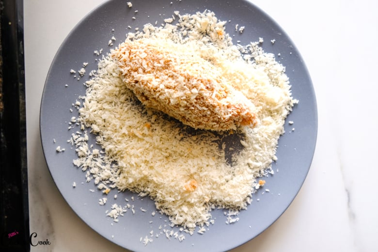 chicken is coated in panko bread crumbs in grey plate