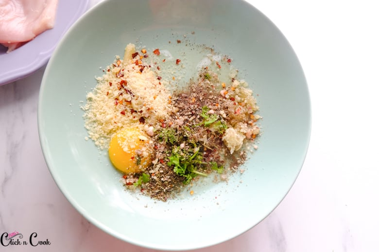 egg and spices are taken in green bowl