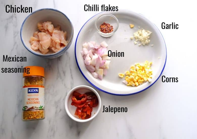 ingredients to make chicken quesadilla are taken in bowls and plates