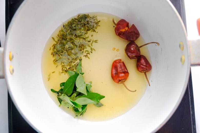 fennel powder, curry leaves and chillies are fried in oil in sauce pan