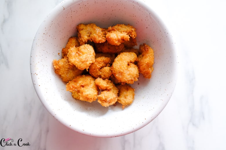 fried shrimps are in white bowl
