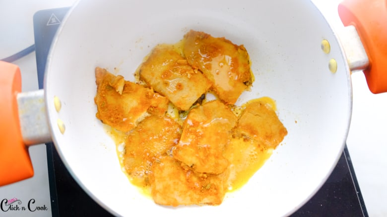 sliced yam is being fried in oil in sauce pot