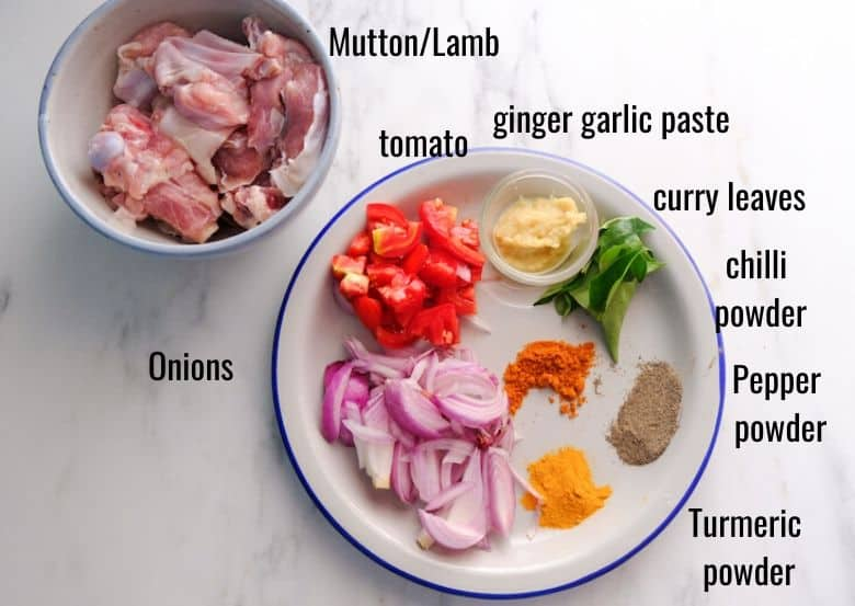 mutton, onion, tomato and spices are taken in plate