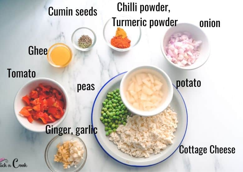 tomato, onion, cottage cheese ingredients are taken in plates for paneer bhurji
