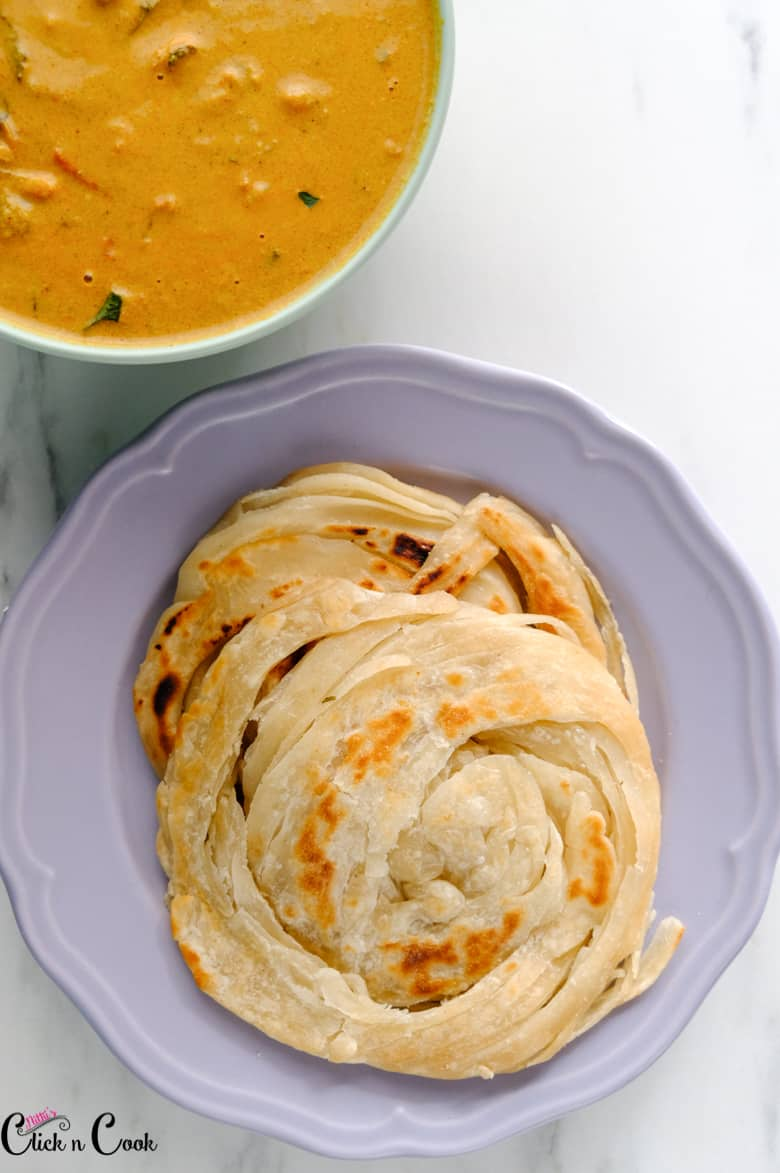 Lachha paratha recipe is on the grey surface