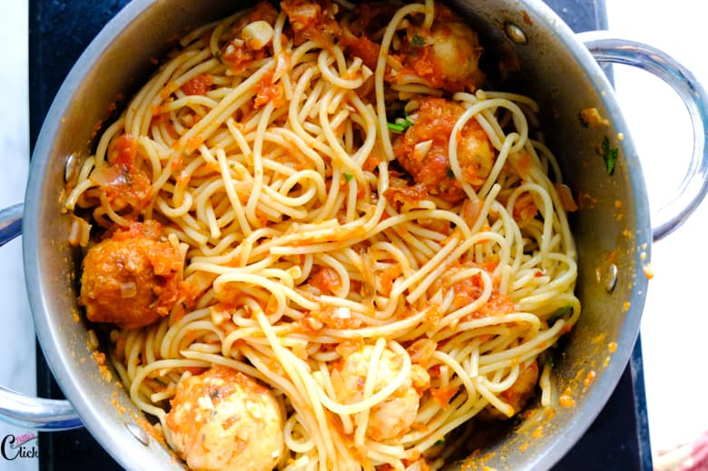 spaghetti and meatballs are in sauce pan
