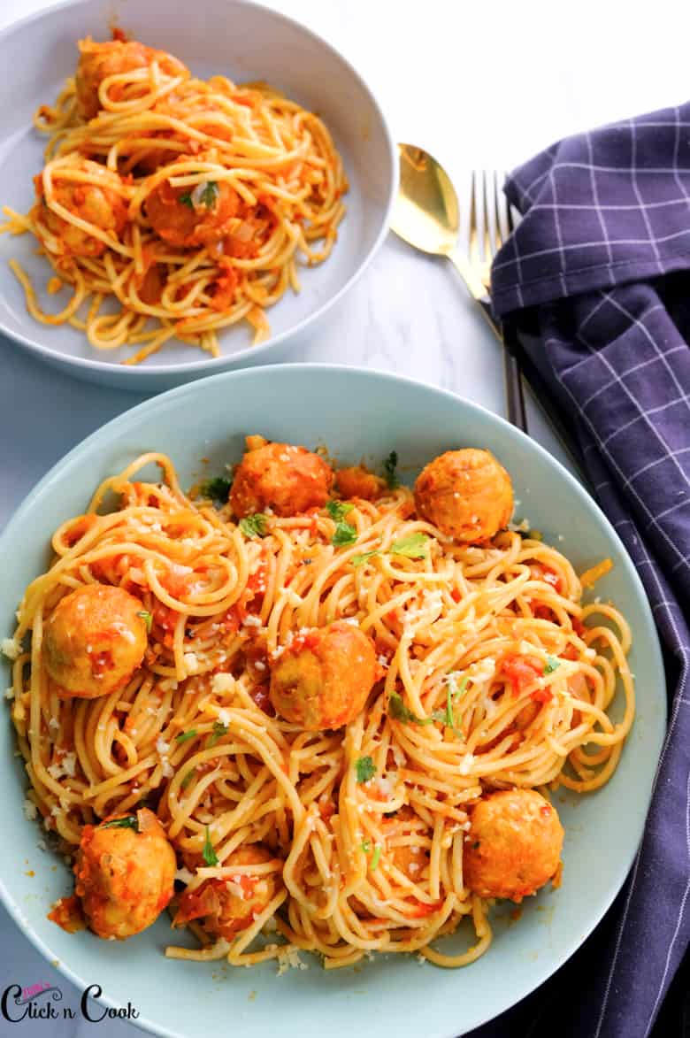 spaghetti and meatballs recipe served in the bowl