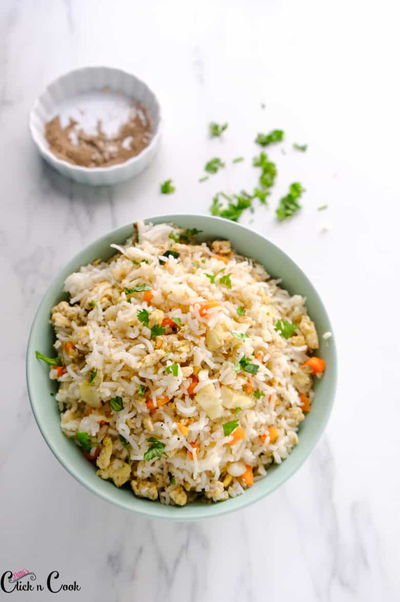 egg fried rice served in green bowl