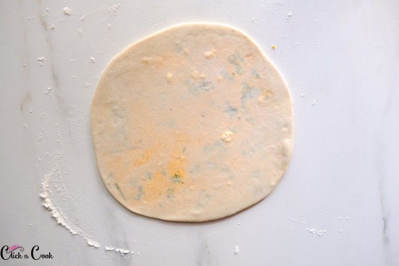 rolled paneer paratha on marble surface