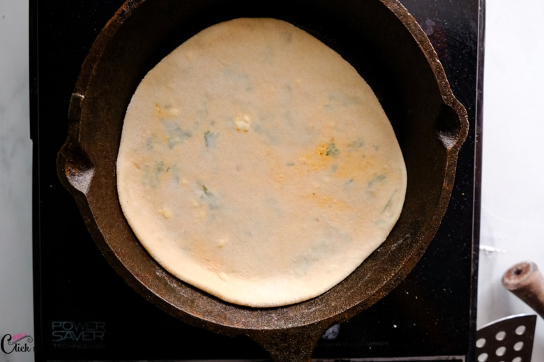 paneer paratha is on the pan