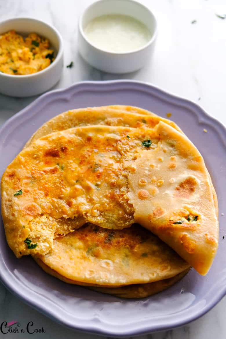 teared paneer paratha recipe on the grey plate