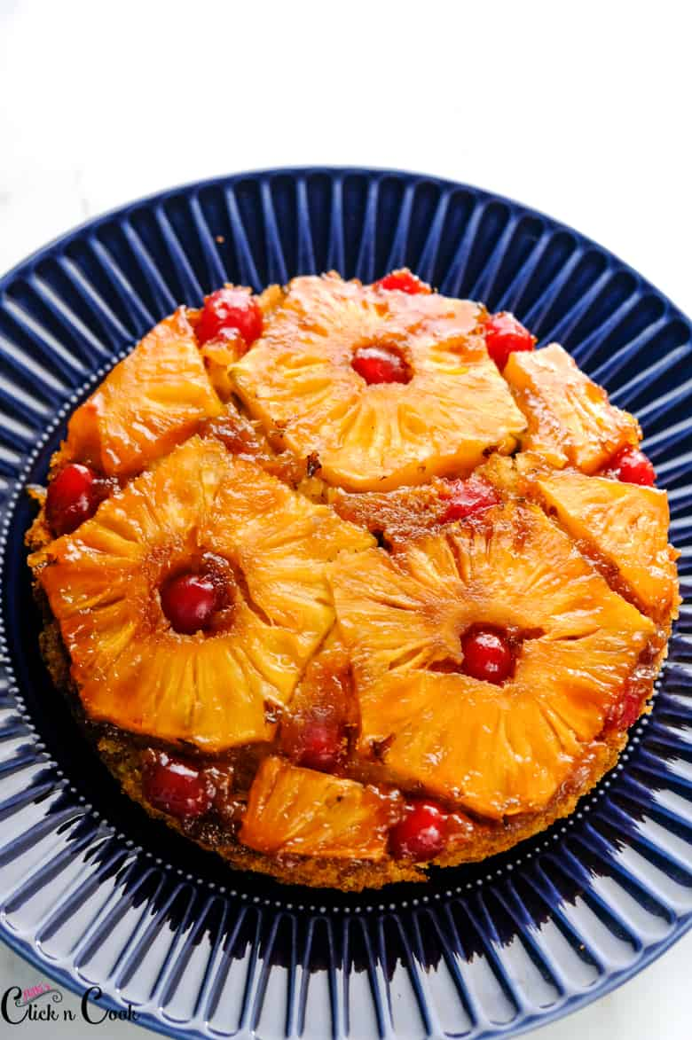 pineapple upside down cake served in blue plate
