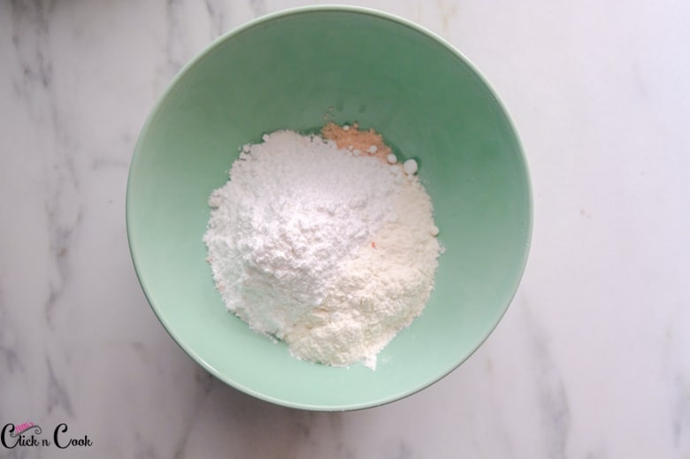 all purpose flour and salt in green bowl
