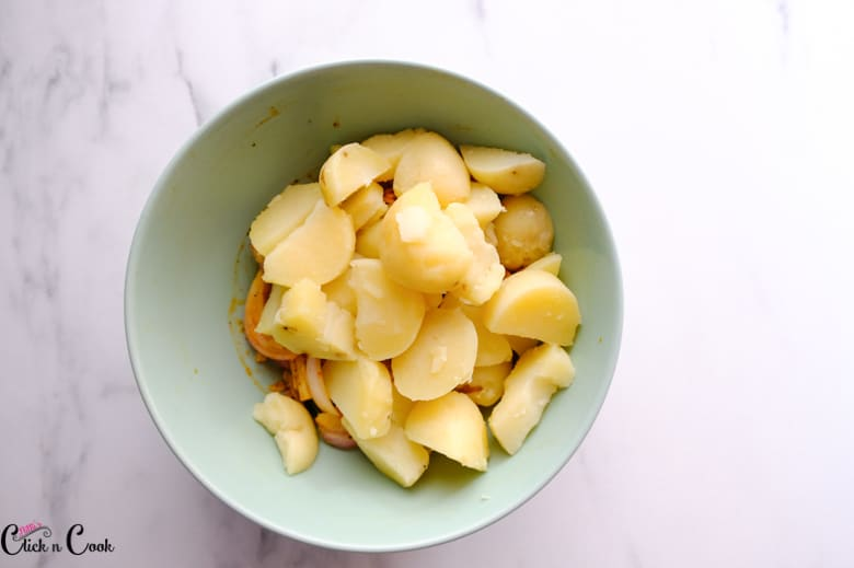 diced potato is in green bowl