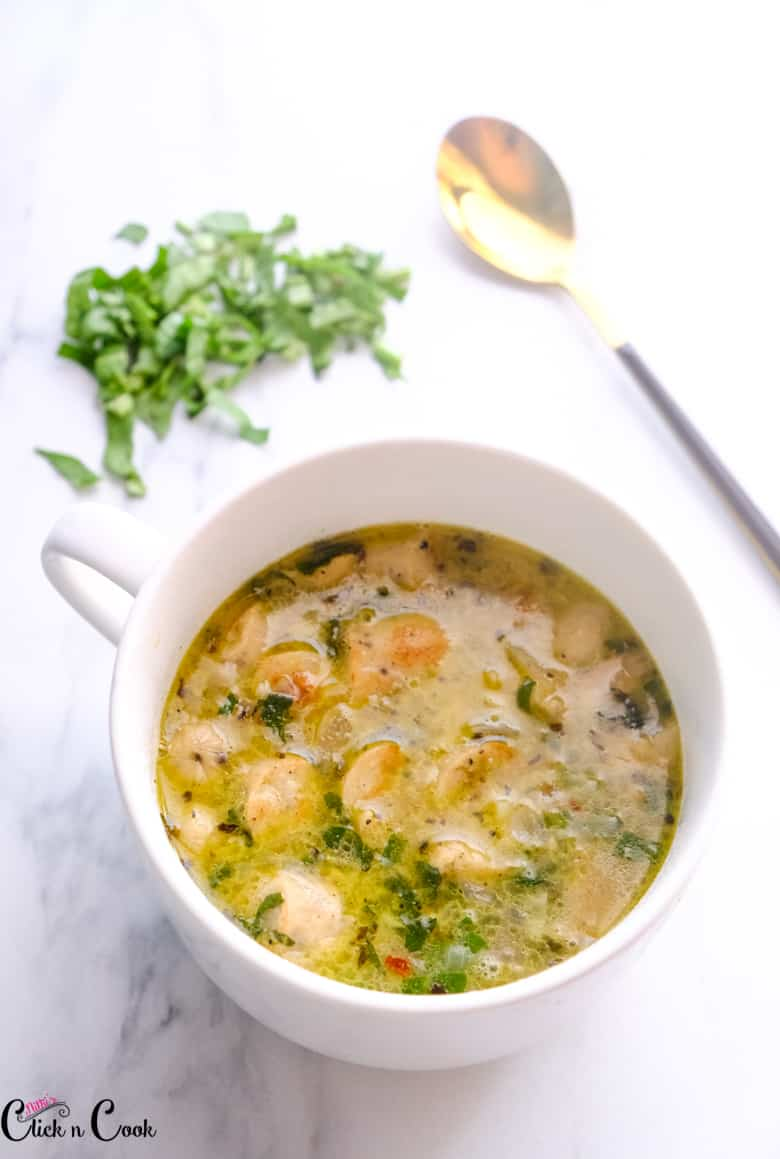 zuppa toscana soup in the soup bowl with spoon aside.
