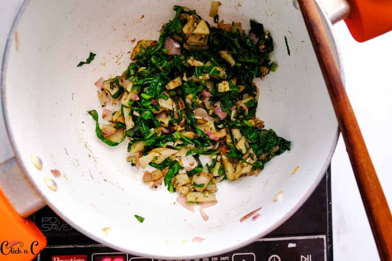 wilted spinach and potato in the sauce pan