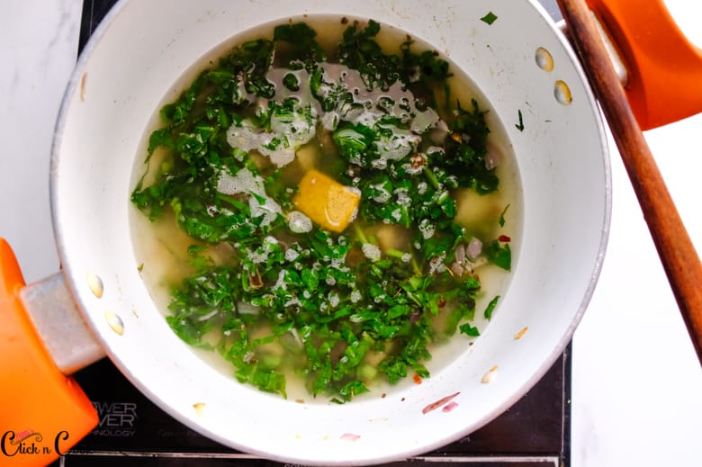 spinach soup with stock cubes in the sauce pan