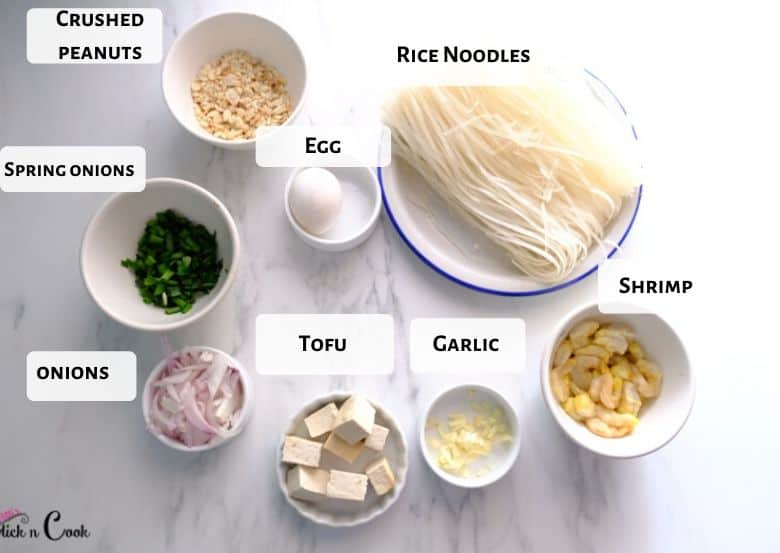 pad thai ingredients are taken in bowls and plate